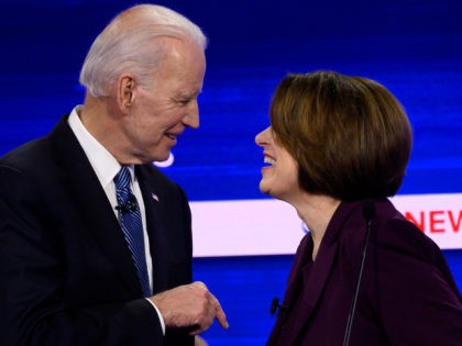 Democratic presidential hopefuls former Vice President Joe Biden (L) and Minnesota Senator Amy Klobuchar speak after the tenth Democratic primary debate of the 2020 presidential campaign season co-hosted by CBS News and the Congressional Black Caucus Institute at the Gaillard Center in Charleston, South Carolina, on February 25, 2020. (Photo …