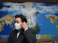 This photo taken on March 1, 2020 shows Kim Shin-chang, director of international missions at the Shincheonji Church of Jesus, adjusting his face mask during an interview with AFP at the headquarters of the church in Gwacheon, south of Seoul. - Officials are trying to track down more than 266,000 …