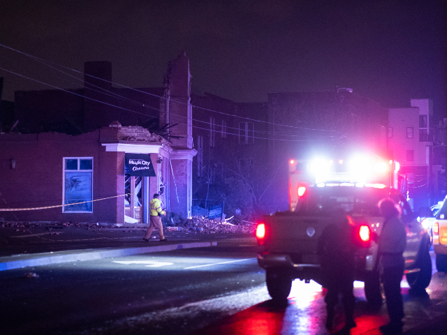 Emergency crews work near a damaged business at Jefferson St. and Seventh Ave. N. on March 3, 2020 in Nashville, Tennessee. A tornado passed through Nashville just after midnight leaving a wake of damage in its path. (Photo by Brett Carlsen/Getty Images)