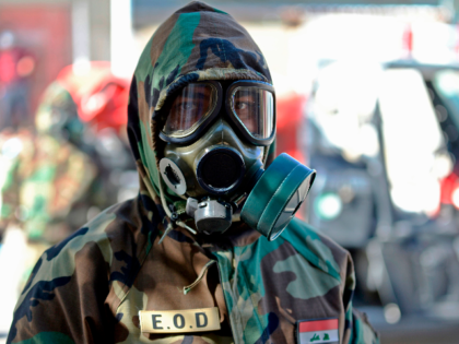 A member of the Iraqi civil defence prepares to disinfect a neighbourhood where a recent case of novel coronavirus infection was confirmed in the central shrine city of Najaf, on March 3, 2020. (Photo by Haidar HAMDANI / AFP) / The erroneous mention[s] appearing in the metadata of this photo …