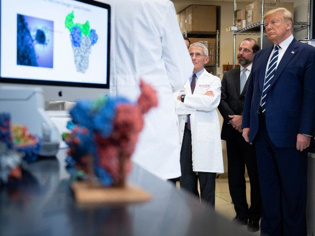 National Institute of Allergy and Infectious Diseases Director Tony Fauci (C) looks on next to US President Donald Trump during a tour of the National Institutes of Health's Vaccine Research Center March 3, 2020, in Bethesda, Maryland. - The US Federal Reserve announced an emergency rate cut responding to the …