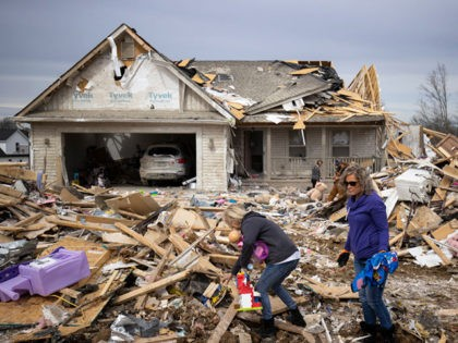 COOKEVILLE, TN - MARCH 04: Families sort through tornado debris to gather possessions on March 4, 2020 in Cookeville, Tennessee. A tornado passed through the Nashville area early Tuesday morning which left Putnam County with 18 killed and 38 unaccounted for. (Photo by Brett Carlsen/Getty Images)