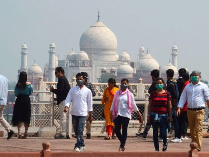 Tourists wear facemasks as a preventive measure against the spread of the COVID-19 coronavirus outbreak, near Taj Mahal in Agra on March 5, 2020. - More than 95,000 people have been infected and over 3,200 have died worldwide from the new coronavirus, which by on March 5 had reached some …