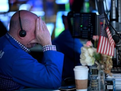 Traders work during the opening bell at the New York Stock Exchange (NYSE) on March 5, 2020 at Wall Street in New York City. - Wall Street stocks tumbled again in opening trading Thursday on fears of a global slowdown due to the coronavirus, extending the run of volatility that …