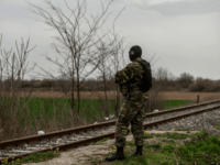 """A Greek army officer patrols at the railway station of Kastanies village, near the Greek-Turkish border on March 8, 2020. - Turkish President Recep Tayyip Erdogan said on March 8, 2020 he will hold talks in Brussels on March 9 as he called on Greece to """"open the gates"""" to …"""