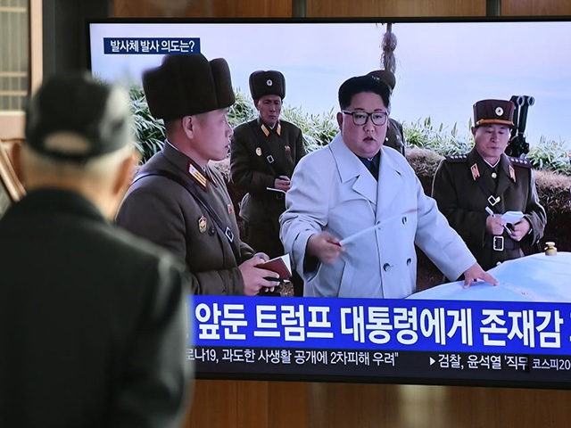 A man watches a television news broadcast showing file footage of North Korea's leader Kim Jong Un, at a railway station in Seoul on March 9, 2020. - Nuclear-armed North Korea on March 9 fired what Japan said appeared to be ballistic missiles, a week after a similar weapons test …