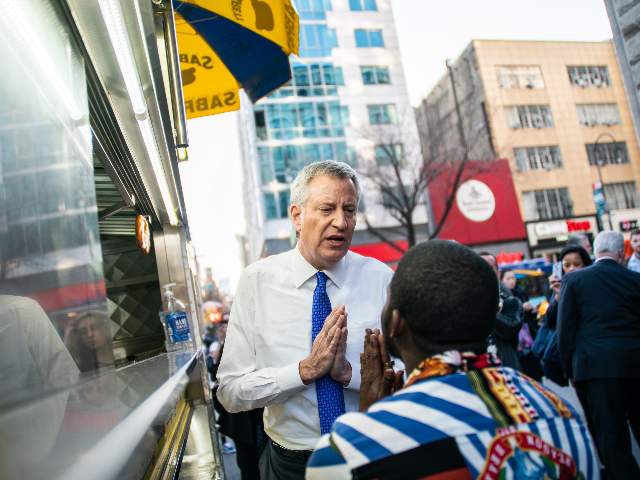 New York Mayor Bill De Blasio talks with a pedestrian Union Square to distribute information about the Coronavirus on March 9, 2020 in New York City. There are now 20 confirmed coronavirus cases in the city including a 7-year-old girl in the Bronx. (Photo by Jeenah Moon/Getty Images)