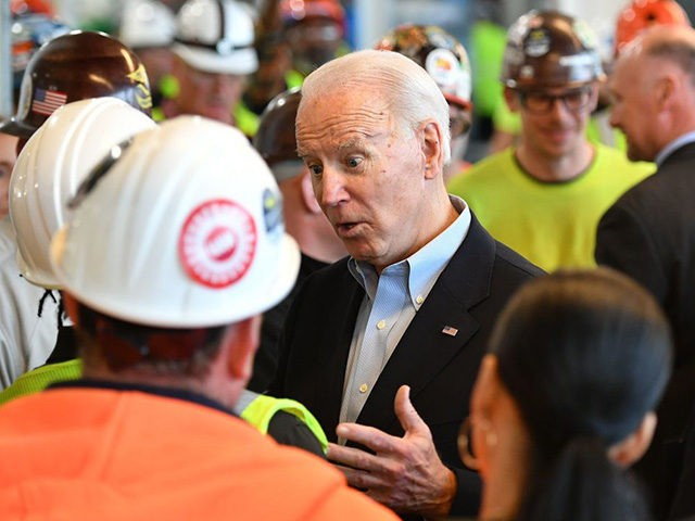 Democratic presidential candidate Joe Biden meets workers as he tours the Fiat Chrysler plant in Detroit, Michigan on March 10, 2020. (Photo by MANDEL NGAN / AFP) (Photo by MANDEL NGAN/AFP via Getty Images)