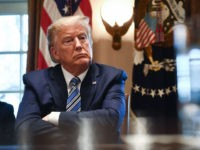 TOPSHOT - US President Donald Trump speaks during a meeting with banking leaders to discuss how the financial services industry can meet the needs of customers affected by COVID-19 at the White House in Washington, DC on March 11, 2020. (Photo by Brendan Smialowski / AFP) (Photo by BRENDAN SMIALOWSKI/AFP …