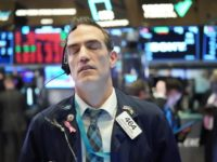 TOPSHOT - Traders work on the floor at the closing bell of the Dow Industrial Average at the New York Stock Exchange on March 11, 2020 in New York. - Wall Street stocks dove deeper into the red in afternoon trading on March 11, 2020, with losses accelerating after the …