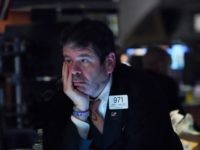 Traders work on the floor at the opening bell of the Dow Industrial Average at the New York Stock Exchange on March 12, 2020 in New York. - Wall Street stocks were deep in the red early Thursday, resuming after a 15-minute suspension as the economic pain from the coronavirus …