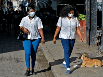 Women wear face masks as they walk along the streets of Havana, on March 12, 2020 as the world following the COVID-19 coronavirus outbreak in the world battles the outbreak of the new coronavirus, COVID-19. - Cuba registered its first three cases on Wednesday. Three Italian tourists, who had arrived …