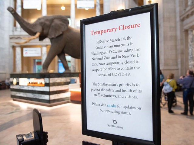 A sign announces a temporarily closure on March 14 due to COVID-19, known as the coronavirus, at the Smithsonian National Museum of Natural History in Washington, DC, March 13, 2020. - The Smithsonian museums will temporarily close on March 14 due to COVID-19, known as the coronavirus. (Photo by SAUL …