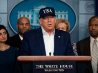 US President Donald Trump gives a press briefing about the Coronavirus (COVID-19) alongside members of the Coronavirus Task Force in the Brady Press Briefing Room at the White House in Washington, DC, March 14, 2020. - President Donald Trump says he has taken coronavirus test and waiting for the result. …
