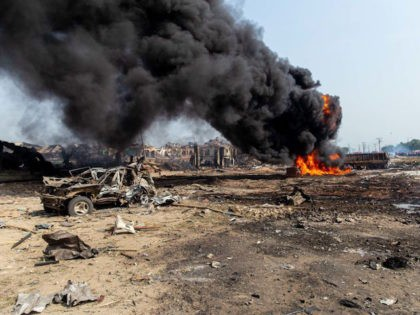 This picture taken on March 15, 2020, shows scattered debris while a fire is still burning after a gas explosion destroyed buildings and killed at least 15 people, in Nigeria's commercial capital Lagos. - A gas explosion in Nigeria's commercial capital Lagos killed at least 15 people, injured many more …