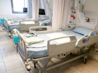 This picture taken on March 16, 2020 during a press presentation of the hospitalisation service for future patients with coronavirus at Samson Assuta Ashdod University Hospital in the southern Israeli city of Ashdod, shows empty hospital beds in a ward. - As of March 16, Israel has 255 confirmed cases …
