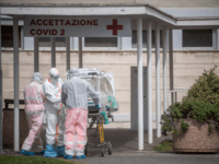 ROME, ITALY - MARCH 17: Medical staff collect a patient from an ambulance at the second Covid-19 hospital in the Columbus unit on March 17, 2020, in Rome, Italy. Italian Government continues to enfoce the nationwide lockdown measures to control the coronavirus spread. (Photo by Antonio Masiello/Getty Images)