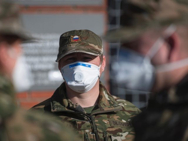 Members of Medical Unit of Slovenian Army wear face masks as they enter the facilities for treatment of coronavirus patients set at the Edvard Peperko Army Barracks in Ljubljana on March 17, 2020, as many countries around the world go into lockdown in an attempt to stem the spread of …