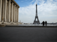 Policemen patrol on the Esplanade du Trocadero square near the Eiffel Tower in Paris, on March 17, 2020 in Paris as a strict lockdown comes into in effect in France to stop the spread of COVID-19, caused by the novel coronavirus. - A strict lockdown requiring most people in France …