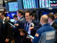 Traders work during the closing bell at the New York Stock Exchange (NYSE) on March 17, 2020 at Wall Street in New York City. - Wall Street stocks rallied Tuesday on expectations for massive federal stimulus to address the economic hit from the coronavirus, partially recovering some of their losses …