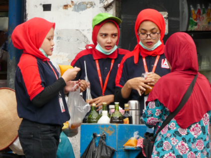 Women purchase turmeric juice, known for its benefits to boost the body's immune system, in Jakarta on March 18, 2020, as countries look to curb the spread of the COVID-19 coronavirus. (Photo by BAY ISMOYO / AFP) (Photo by BAY ISMOYO/AFP via Getty Images)