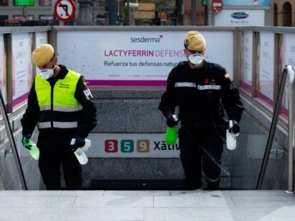 Members of the Military Emergencies Unit (UME) carry out a general disinfection at a metro station in Valencia on March 18, 2020. - The number of people infected by COVID-19 in Spain soared past 13,700 today with the number of deaths rising to almost 600, government data showed. Over the …