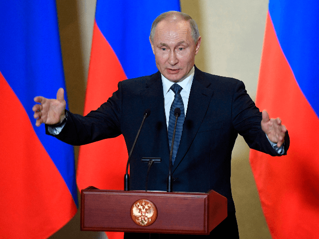 Russian President Vladimir Putin gives a speech during an awards ceremony for those who led the construction of the 19 kilometres (12 miles) road and rail Crimean Bridge over the Kerch Strait - that links mainland Russia to Moscow-annexed Crimea - in Sevastopol, Crimea, on March 18, 2020. (Photo by …
