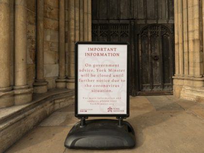 A notice outside York Minster informs members of the public that it has been closed in light of the coronavirus pandemic, in the centre of York, northern England, on March 19, 2020. - Britain announced Wednesday it would be closing schools in the coming days and placing 20,000 troops on …