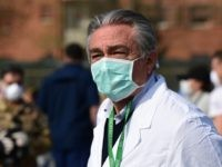 A view taken on March 20, 2020 in Cremona, southeast of Milan, shows Healthcare Director of the Cremona hospital, Rosario Canino looking on during the installation of a newly operative field hospital for coronavirus patients, financed by US evangelical Christian disaster relief NGO Samaritans Purse. - Fully operational, the structure …
