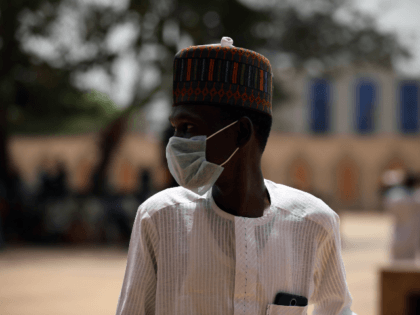 A Muslim faithful wears a face mask amid concerns of the spreading of the COVID-19 coronavirus at the National Mosque before the Friday prayers in Abuja, Nigeria, on March 20, 2020. - Nigeria said on March 19, 2020, it would shut schools and limit religious meetings in its economic hub …