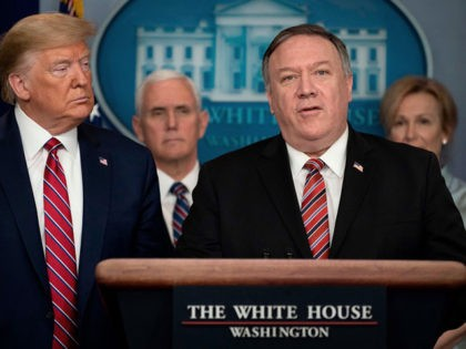 US President Donald Trump listens as Secretary of State Mike Pompeo speaks during the daily briefing on the novel coronavirus, COVID-19, at the White House on March 20, 2020, in Washington, DC. - Pompeo told China to make coronavirus details 'available to the whole world' (Photo by JIM WATSON / …