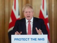 LONDON, ENGLAND - MARCH 20: British Prime Minister Boris Johnson gestures as he speaks during a daily press conference at 10 Downing Street on March 20, 2020 in London, England. During the press conference, British Prime Minister Boris Johnson told pubs, cafes, bars, restaurants and gyms to close, whilst Chancellor …
