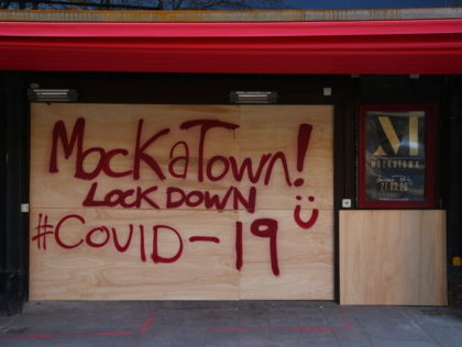 A sign in spray paint informs customers that the Mokatown launch party is cancelled due to the coronavirus outbreak in Cardiff on March 24, 2020 after Britain ordered a lockdown to slow the spread of the novel coronavirus. - Britain was under lockdown March 24, its population joining around 1.7 …