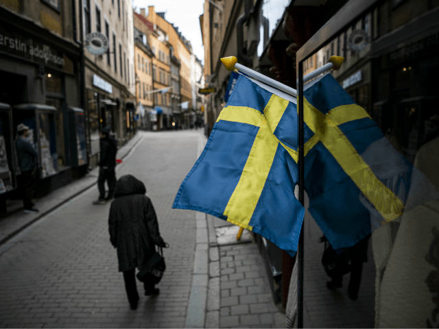 People walk in the main street of the old town in Stockholm, Sweden, where primary schools, restaurants and bars are open and people encouraged to go outside for a nip of air, while the rest of Europe is in lockdown in a bid to curb the spread of COVID-19, on …