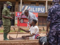 A police officer arrests a man on a street in Kampala, Uganda, on March 26, 2020, after Ugandan President Yoweri Museveni directed the public to stay home for 32 days starting March 22, 2020 to curb the spread of the COVID-19 coronavirus. - Ugandan authorities have identified 14 confirmed cases …