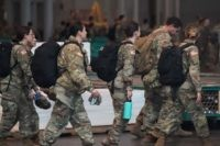 Members of the Army National Guard arrive to the Jacob K. Javits Center on March 27, 2020 in New York. - The New York National Guard, the US Army Corps of Engineers, and Javits employees are constructing a 1,000-bed facility at the center, as the state tries to contain the …