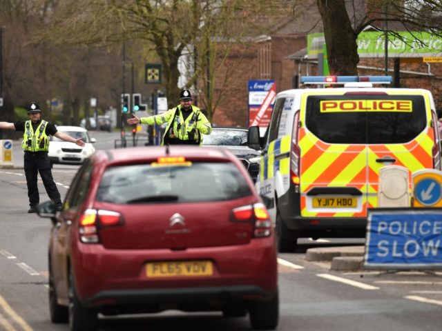 "Police officers from North Yorkshire Police stop motorists in cars to check that their travel is ""essential"", in line with the British Government's Covid-19 advice to ""Stay at Home"", in York, northern England on March 30, 2020, as life in Britain continues during the nationwide lockdown to combat the novel …"