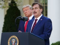US President Donald Trump listens as Michael J. Lindell, CEO of MyPillow Inc., speaks during the daily briefing on the novel coronavirus, COVID-19, in the Rose Garden of the White House in Washington, DC, on March 30, 2020. (Photo by MANDEL NGAN / AFP) (Photo by MANDEL NGAN/AFP via Getty …
