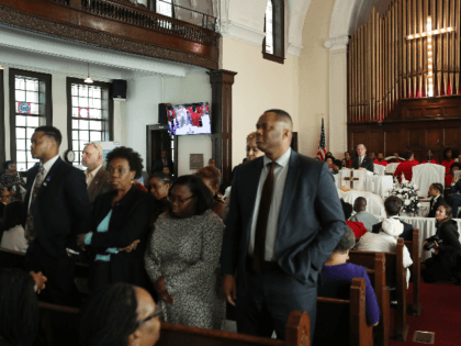 People stand with their backs to Democratic presidential candidate, former New York City mayor Mike Bloomberg as he speaks during a worship event at the Brown Chapel AME Church on March 1, 2020 in Selma, Alabama. The people turned their backs because of among other issues they disagree with Mr. …
