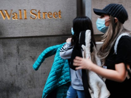NEW YORK, NEW YORK - MARCH 09: People walk by the New York Stock Exchange (NYSE) on March 09, 2020 in New York City. The Dow Jones Industrial Average fell more than 2,000 points as investors concerns over the spreading coronavirus continue to affect global markets. (Photo by Spencer Platt/Getty …