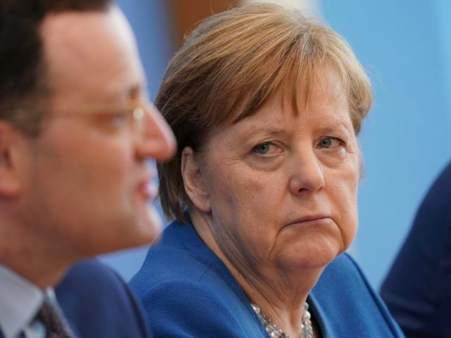 BERLIN, GERMANY - MARCH 11: German Health Minister Jens Spahn and German Chancellor Angela Merkel speak to the media over the ongoing coronavirus spread in Europe on March 11, 2020 in Berlin, Germany. The number of confirmed cases of coronavirus is continuing to rise dramatically in Germany and has topped …