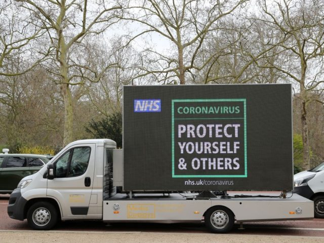 LONDON, ENGLAND - MARCH 17: A NHS Public Health information van drives around central London on March 17, 2020 in London, England. Boris Johnson held the first of his public daily briefing on the Coronavirus outbreak yesterday and told the public to avoid theatres, going to the pub and work …