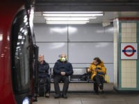 VARIOUS CITIES, - MARCH 23: Commuters wearing face protection masks travel on the Central Line on March 23, 2020 in London, United Kingdom. Coronavirus (COVID-19) pandemic has spread to at least 182 countries, claiming over 10,000 lives and infecting hundreds of thousands more. (Photo by Justin Setterfield/Getty Images)