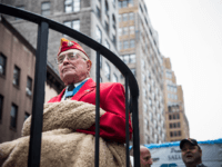 "United States Marine Hershel ""Woody"" Williams, a Medal of Honor recipient and the last surviving member of the famous Iwo Jima flag raising photo, rides on a float during the Veteran's Day Parade on November 11, 2013 in New York City. The parade included members of all four branches of …"