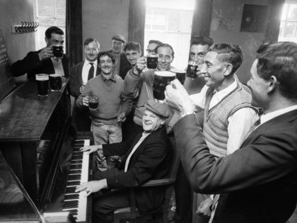 13th October 1963: A group of men from the Atlantic Island of Tristan da Cunha gather for a pint and a sing-song at the local before leaving England. (Photo by Reg Lancaster/Express/Getty Images)