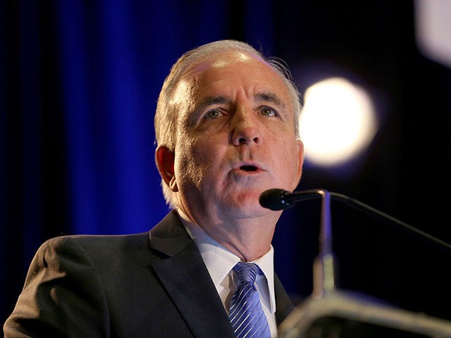 MIAMI BEACH, FL - OCTOBER 01: Carlos A. Gimenez, Mayor, Miami-Dade County speaks during the opening day of the 6th Annual Southeast Florida Climate Leadership Summit where South Florida community leaders along with climate change experts are meeting at the Miami Beach Convention Center to discuss regional plans for adapting …