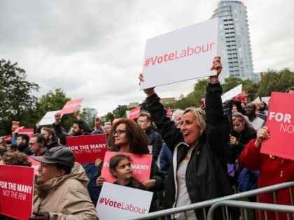CROYDON, ENGLAND - JUNE 06: Supporters cheer during a Labour Party rally in Park Hill park on June 6, 2017 in Croydon, England. Labour Leader Jeremy Corbyn appears via satellite to five separate rallies across the country this evening. Tomorrow marks the final day of campaigning for the political parties …