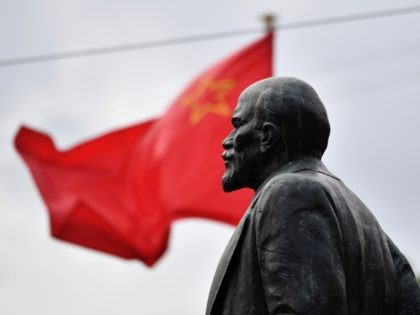 A photo taken on June 26, 2017 shows a sculpture of the founder of the Soviet Union Vladimir Lenin in front of the administration building of the Vasileostrovsky district of Saint Petersburg. This year Russia will mark the 100 Anniversary of the Bolshevik Revolution also known as the October Revolution …