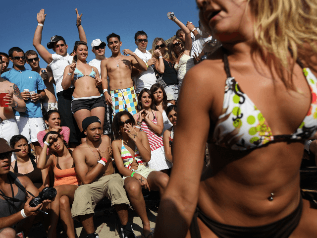 "Students participate in a ""booty shaking"" contest at the MTV Beach Bash party put on by Global Groove at the Bahia Mar Hotel during the annual ritual of Spring Break March 26, 2008 on South Padre Island, Texas. The South Texas island is one of the top Spring Break destinations …"