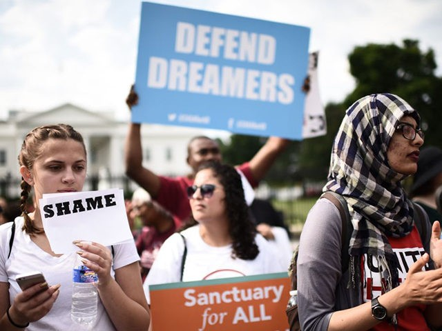 Immigrants and supporters demonstrate during a rally in support of the Deferred Action for Childhood Arrivals (DACA) in front of the White House on September 5, 2017 in Washington DC. US President Donald Trump has rescinded the program, ending amnesty for 800,000 young immigrants brought to the US illegally as …